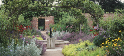 The Pear Avenue in the Kitchen Garden at Beningbrough Hall, with Monarda