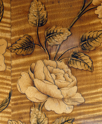 Rose inlay on 18th century commode at Nostell Priory