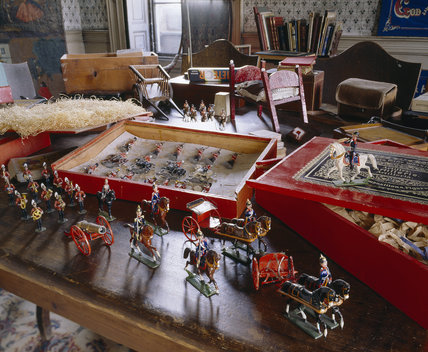 Close-up of a table with toy soldiers, other figures and toys in the Schoolroom at Calke Abbey