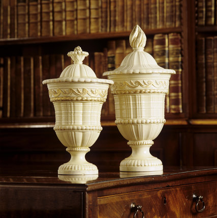 Two cream-covered earthenware vases and covers, c 1765