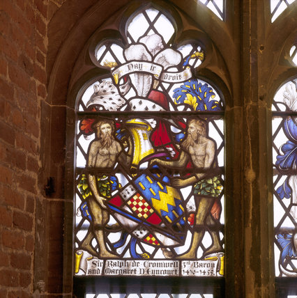 An heraldic stained glass window commemorating Sir Ralph Cromwell