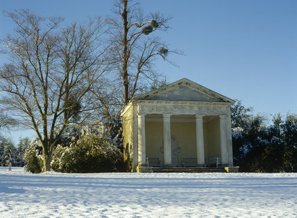 A winter scene of the Doric Temple in the garden at Petworth House in the snow