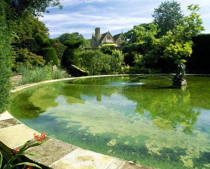 Bathing Pool Garden with the manor house in the distance, at Hidcote, Oxfordshire