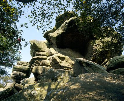Looking up at the strange rock formations at Brimham Rocks, Harrogate, North Yorkshire