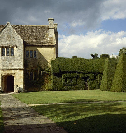 Exterior of the house with topiary