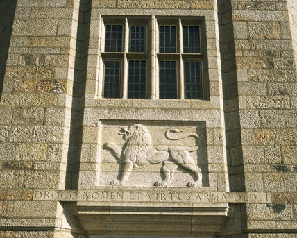 Carved stone lion on the main entrance front at Castle Drogo, Devon, designed by Sir Edwin Lutyens and built between 1911 and 1931