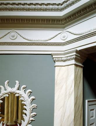 Entrance hall, details of marbled pilaster, girandole and frieze
