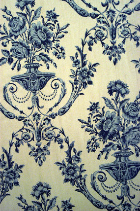 A detail of blue and white wallpaper, reproduced from the original C19th paper, in the Oak Hall at Petworth House