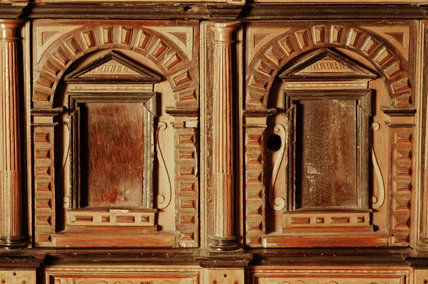 A South German Augsburg marquetry cabinet of architectural design, c.1560, part of the Charles Wade collection in Seraphim at Snowshill Manor, Gloucestershire.