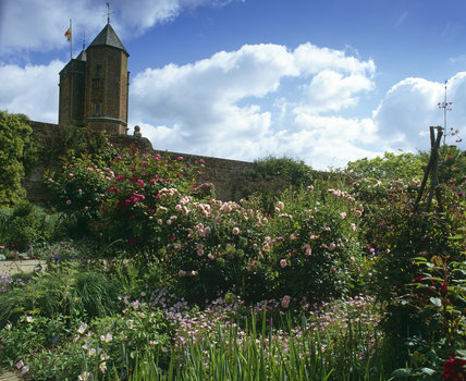 View towards the Elizabethan Tower at Sissinghurst Castle Garden, Kent, across the Rose Garden in the summer