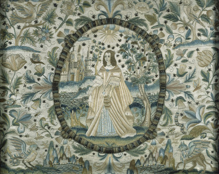 Mid-18th century textile panel in the Great Chamber at East Riddlesden Hall, depicting a lady in a landscape enclosed in an oval cartouche, possibly representing the personification of a season or virtue