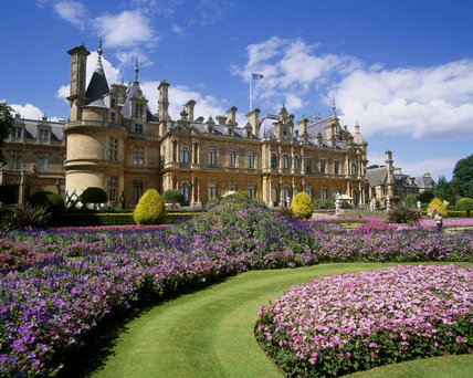 View of Waddesdon manor with bright summer bedding in pink & purple