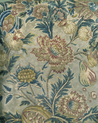 Close view of the textile covering of an 18th-century wing armchair at East Riddlesden Hall