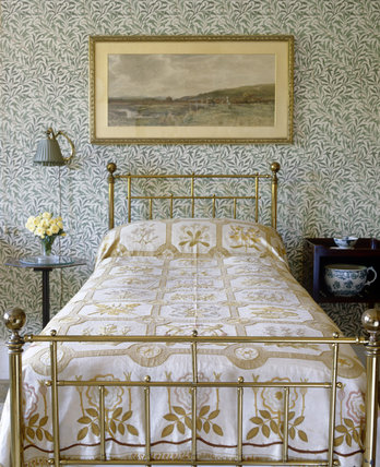 Heal's brass bedstead in the Willow Bedroom at Standen, West Sussex with