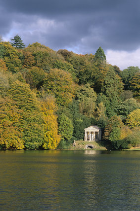 View across lake at Stourhead towards the Temple of Flora