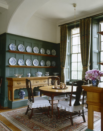 The Dining Room looking towards the window and fitted dresser at Standen, West Sussex