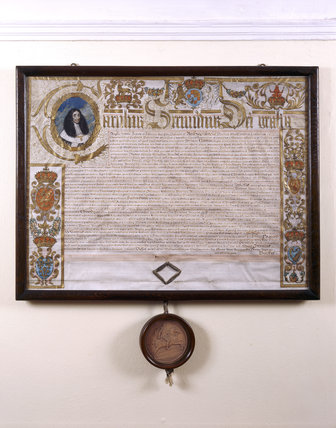 A patent from Charles II granting Richard Arundell a baronetcy in 1664 in gratitude for his father's loyalty to the Crown during the Civil War