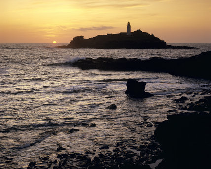 View from Godrevy Point to the lighthouse at sunset