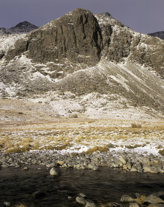 Snow covered view of Scafell Pike and Dow Crag from Great Moss in Cumbria