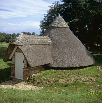 View of the thatched, restored, c19th Ice-house