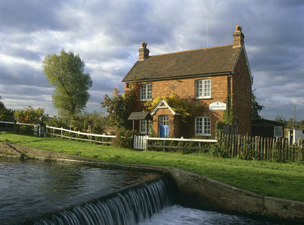 Lock Keeper's Cottage by the weir of Papercourt Lock