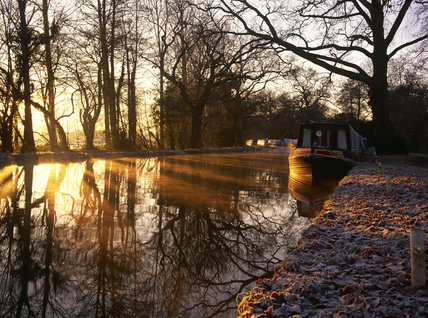 Frosty dawn light strikes narrowboats between Pyrford and Walsham Locks