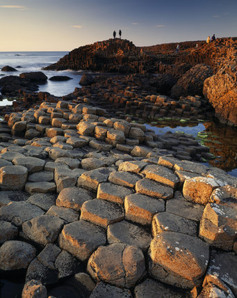 The Giant's Causeway is a geological phenomenon renowned for its polygonal columns of layered basalt, caused by a volcanic eruption 60 million years ago