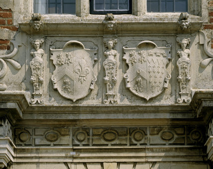 A close up view of the stone shields above the main door of the south front of Felbrigg Hall