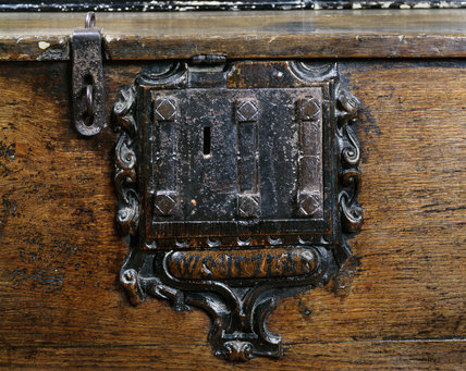 Detail of an ornamental lock on an oak dower chest at Sizergh Castle