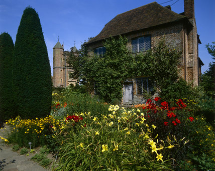 South Cottage, the rose-smothered brick cottage at Sissinghurst with colourful flowers in high summer