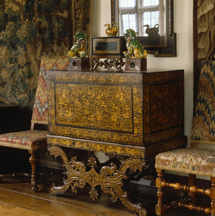 View of a chinoiserie lacquer chest with Dogs of Fo ornaments, in the Long Gallery at Packwood House