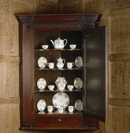 Close-up of the corner cupboard with 18th century tea service of Dr Wall Worcester china in the Study at Packwood House