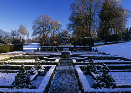 A view of the snow covered parterre at Clandon Park