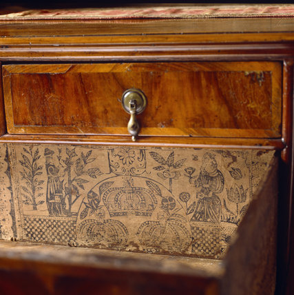 Close-up of a William and Mary chest veneered in walnut in Queen Margaret's Room at Packwood House