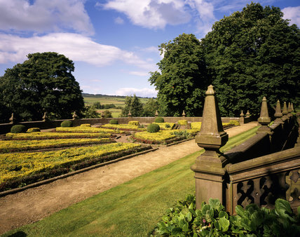 A view of the North Parterre at Gawthorpe Hall, with the Lancashire fields in the distance