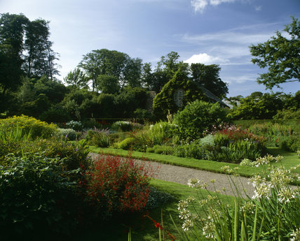A view of the round herbaceous gardens running through Lanhydrock on a bright sunny day