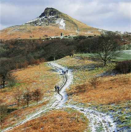 Several walkers traversing the snowy path up the Topping, North Yorkshire