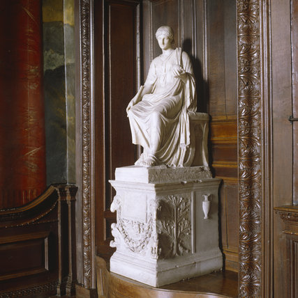 View of marble funerary altar of a Muse on a plinth in the Grand Staircase at Powis Castle