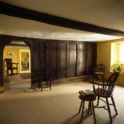 The original plank and muntin screen in the Parlour with the doorway to the Hall at Marker's Cottage