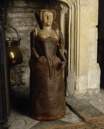Detail of a leather lady, one of two on either side of the fireplace in the Great Hall at Lytes Cary, probably made in the C19th