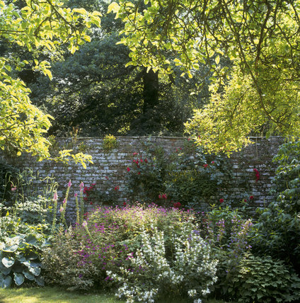 Part of the sunken garden with numerous flowering shrubs, bushes and trees