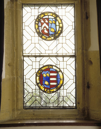 A piece of stained glass,hanging in the triple-light windows, attributable to John Lyte and dating from the first half of the C16th