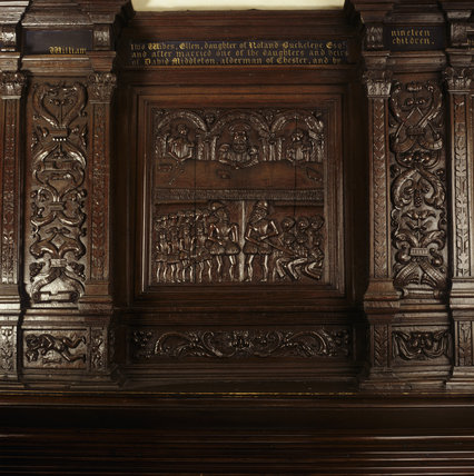A detailed close up of the ornate carving and genealogy in the Drawing Room (previously known as the Great Parlour