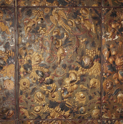 A detailed close up of the embossed leather that covers the walls in the East Hall