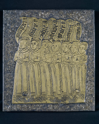 Replica of an Arundell family brass, a group of ladies with a Latin inscription,  at Trerice, Cornwall, UK
