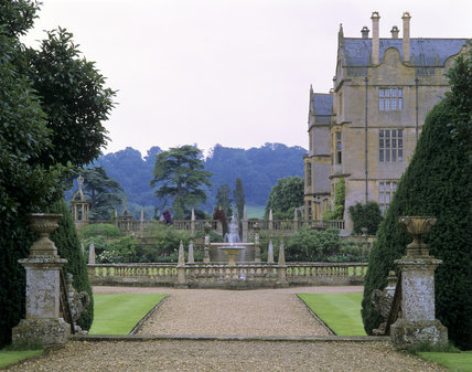 A view through the balustraded walls of the garden at Montacute House, Somerset, with a fountain at the centre
