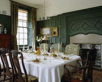 The Dining Room at Standen, West Sussex with the table set for dessert