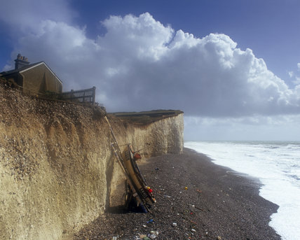 View along the cliffs at Birling Gap with beach and foaming sea