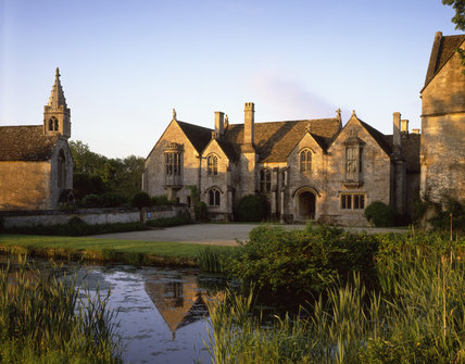 The North front across the moat and forecourt of Great Chalfield Manor, near Melksham, Wiltshire