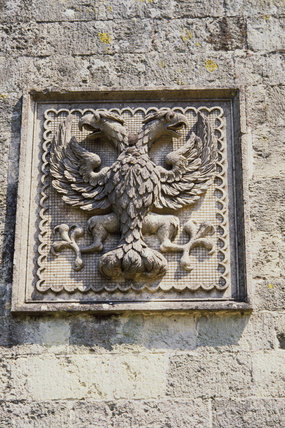 A Coat of Arms in stone, showing a two headed eagle
